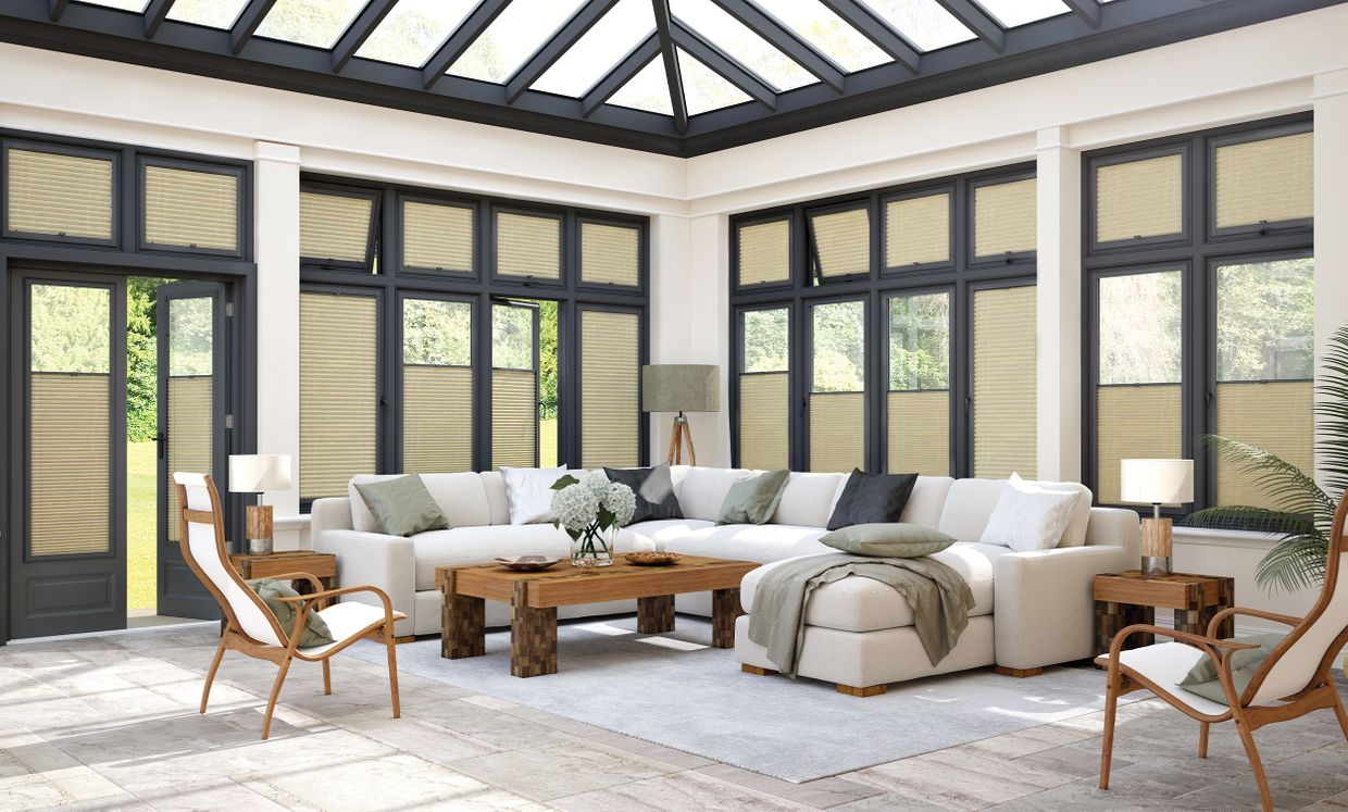 cream perfect fit blinds in a modern conservatory living room