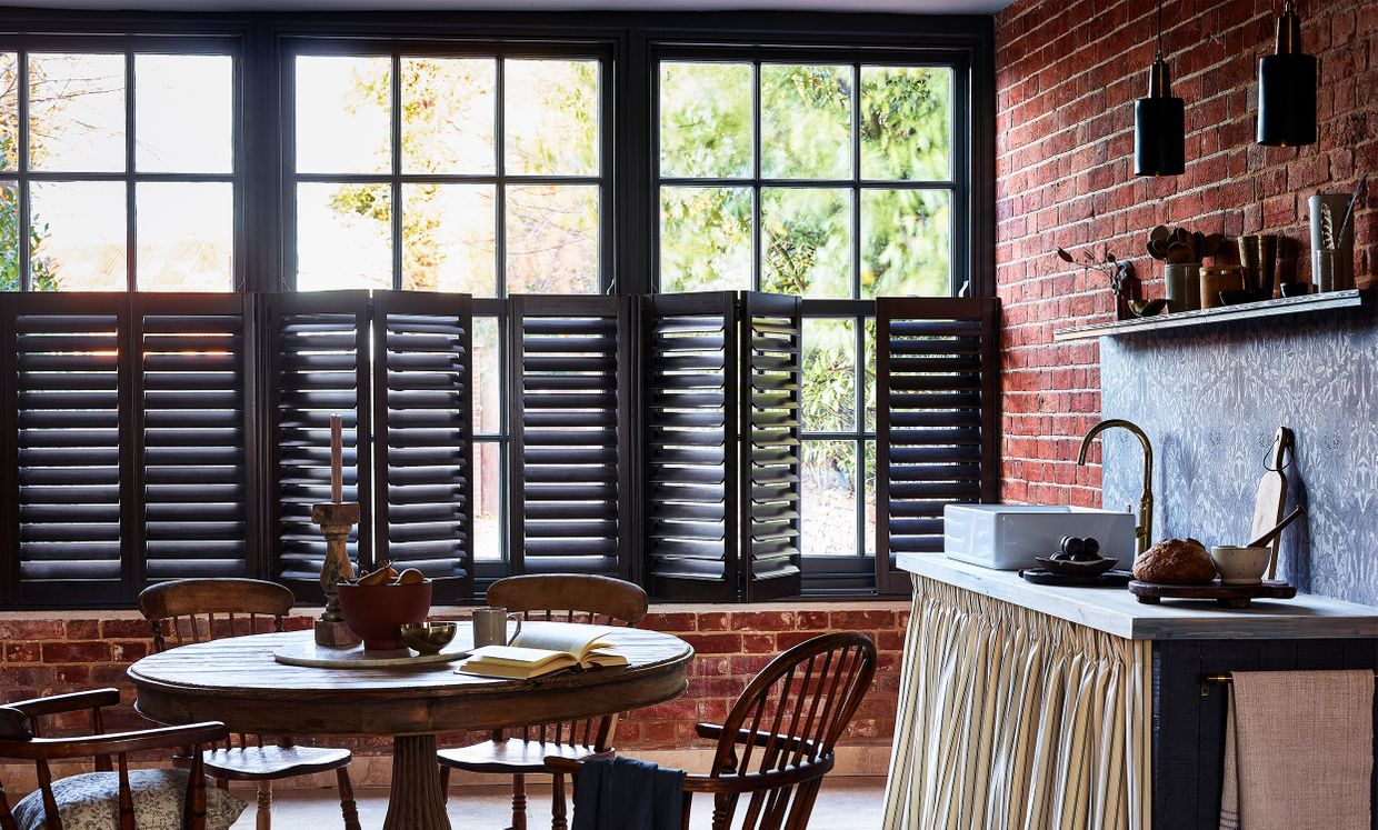 brown cafe style shutters in a modern kitchen dining room window