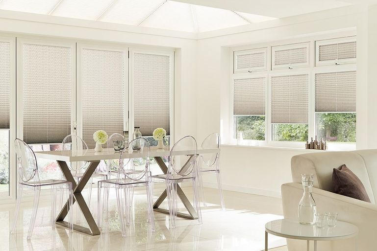 Grey perfect fit blinds in conservatory room