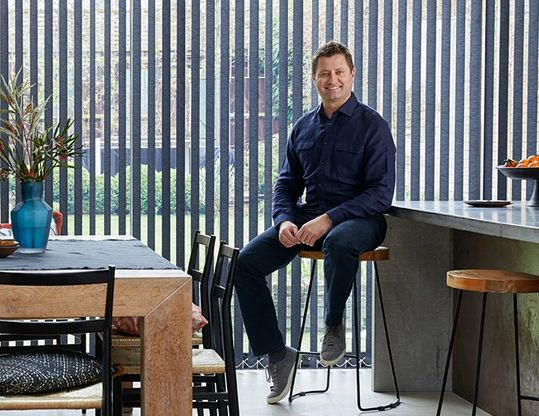 George Clarke in front of Norfolk Charcoal vertical blind