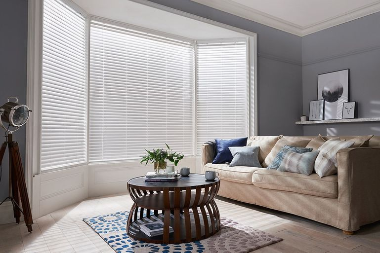 Fine White wooden blinds in living room