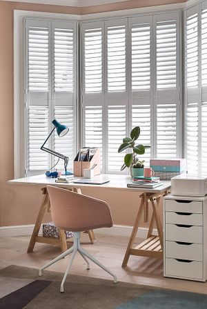 Richmond White Full Height Shutters in home office above desk and chair
