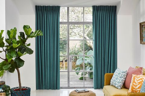Garden Room with Teal Curtains in Clarence Teal Fabric