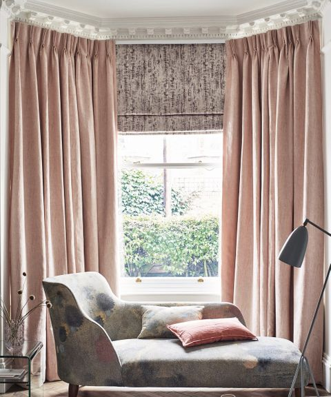 Luxe Pink living room with Pink Curtains in Mineral Blush fabric layered with a Grey Pattern Roman Blind
