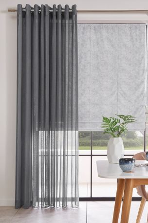 Voile in Serene Grey paired with Roman Blinds in Forest Heather in dining room