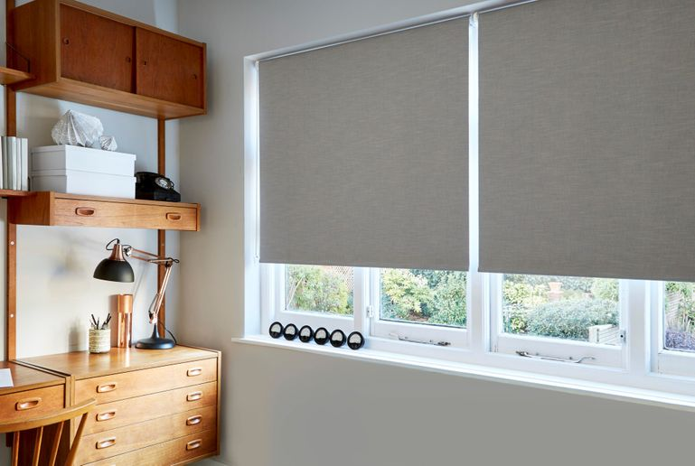 grey roller blinds in study office
