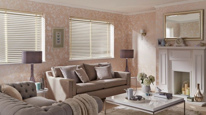 Traditional living room in soft pink hues with cream venetian blinds