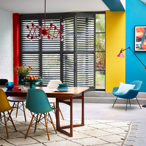 vibrant dining room with coloured shutters