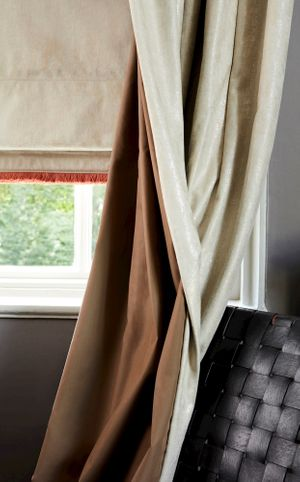 Lucien Dust curtains with barrel lining and roman blinds.