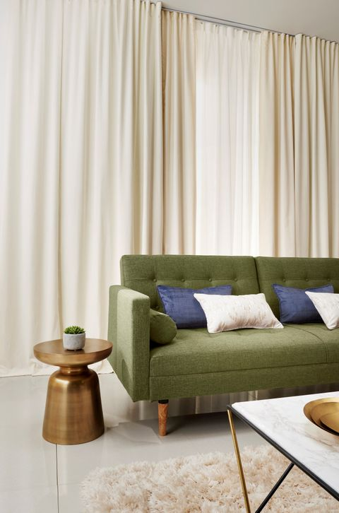 Minimal Luxe Living Room with Tetbury Ivory Voile curtains layered under Cream Curtains