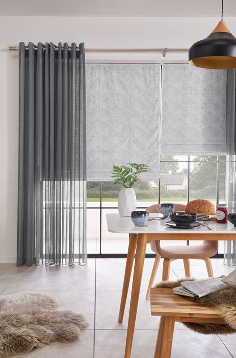 Dining Room with Serene Grey Voile curtains layered over Forest Heather Grey Roman blind
