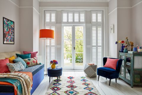 Living Room with Colourful Accent Decor and Pure White Shutters