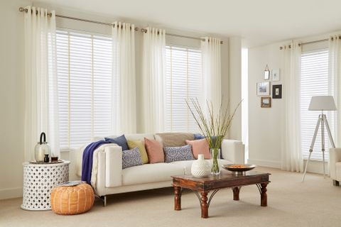 Plain Living Room with Colourful Cushions and Voile Curtains