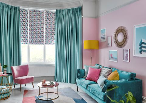 Colourful and Eccentric Bedroom decorated with Pinch Pleat Curtains in Harlow Turquoise Fabric paired with Jazz Fuschia Roller Blinds