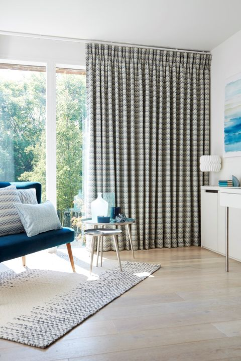 Peaceful Living Room with floor to ceiling window dress with Pinch Pleat Curtains in Lazio Marine Fabric