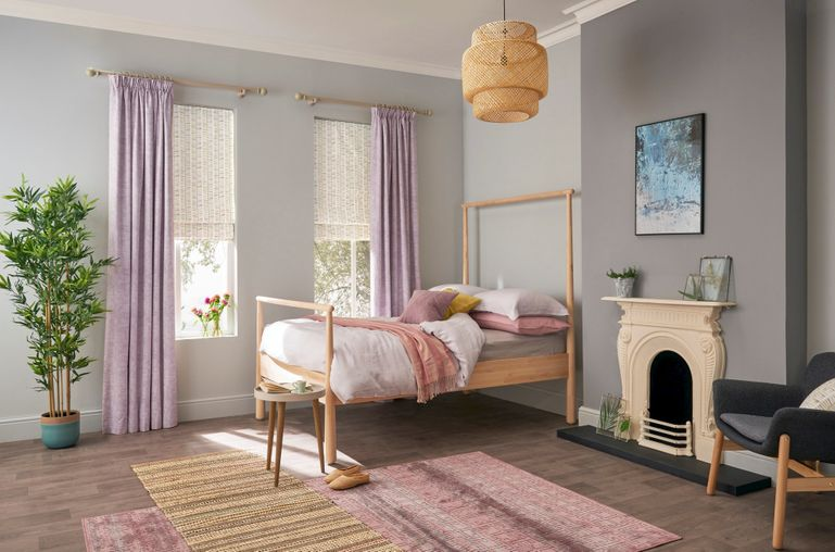 Child's bedroom with two windows dressed with children's curtains in lilac purple fabric