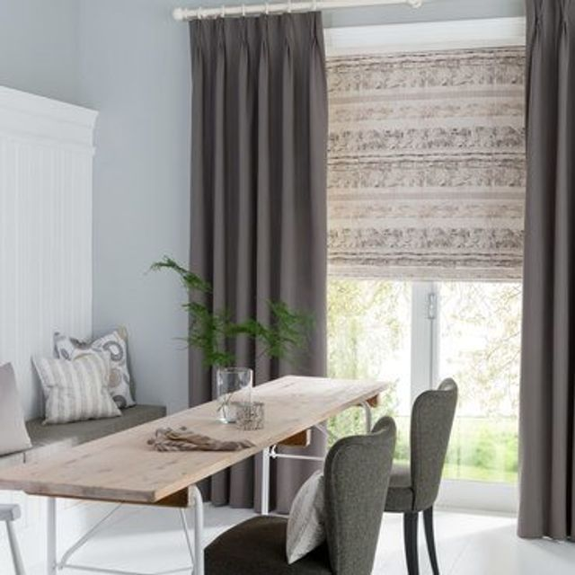 Tetbury Charcoal Curtains in dining room with wooden dining table and grey chairs