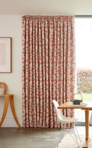 Pink patterned curtains in Honesty Persimmon fabric