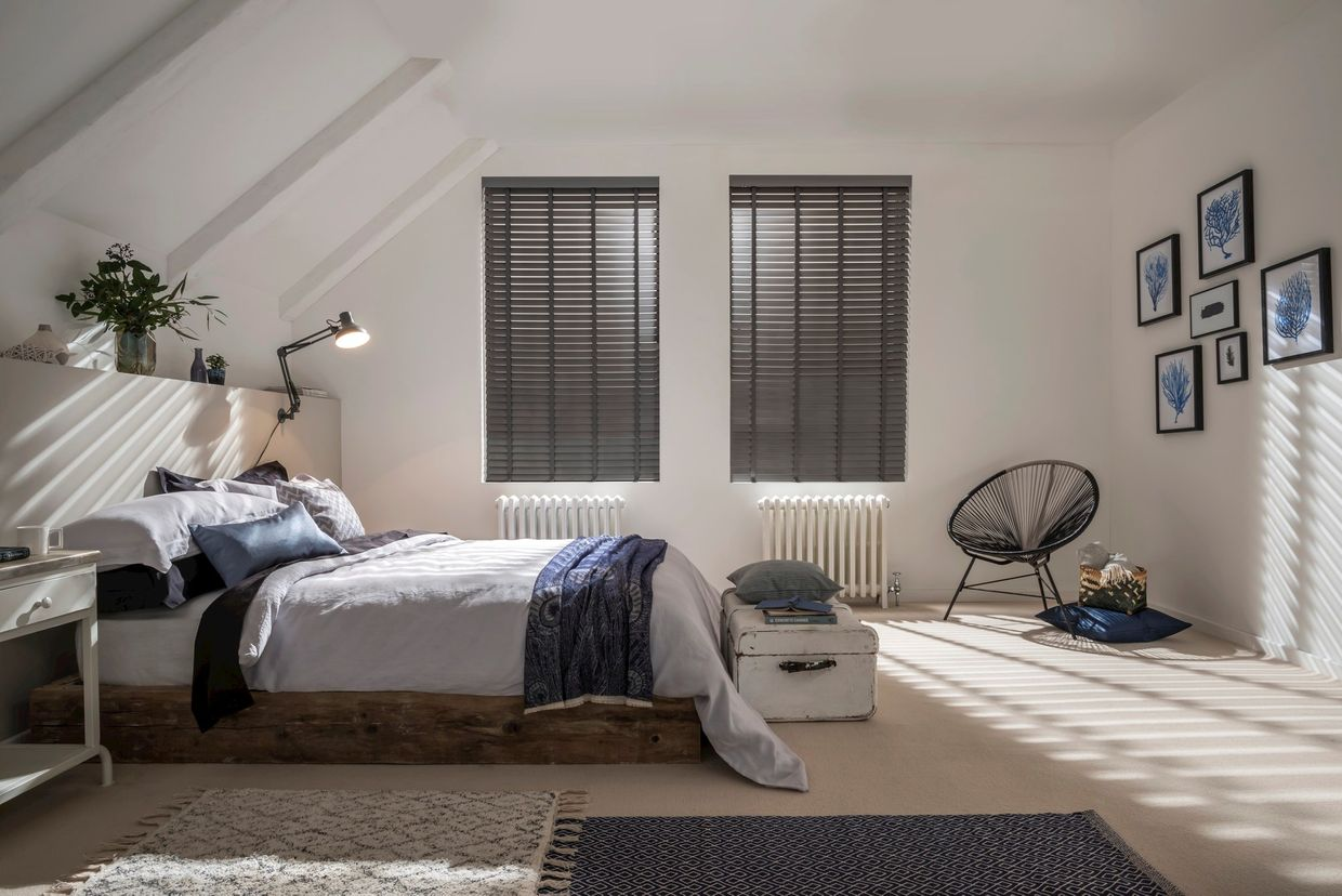 dark grey venetian blinds in a bedroom window