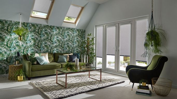 tropical theme room with acacia silver color roller blinds on patio door and skylight windows