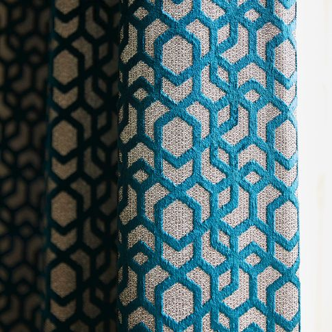 Close up detail of blue and silver velvet geometric curtain