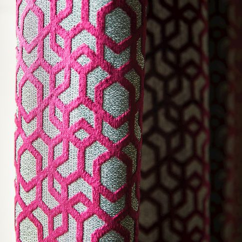 Close up detail of pink laser cut velvet geometric curtain
