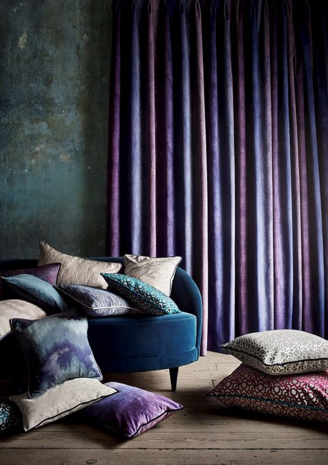 Close up detail of curtain fabric and cushions from the Mercury collection
