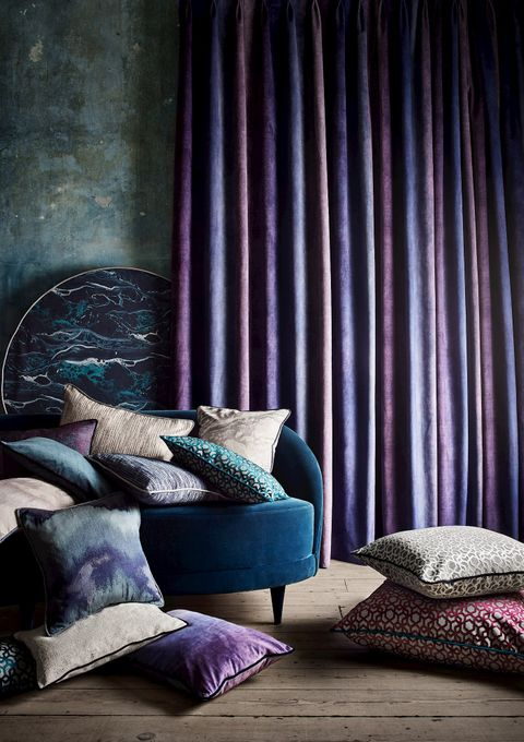 Close up detail of sofa with cushions covered in a selection of Mercury collection fabrics