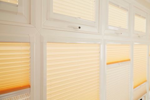 Close up of yellow thermal blinds in conservatory