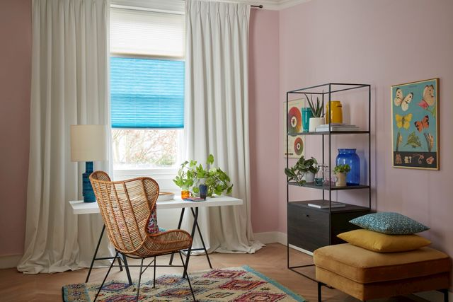 Colourful and artistic home office with blue thermal blinds
