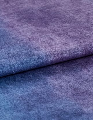 Folded fabric in a rich purple colour
