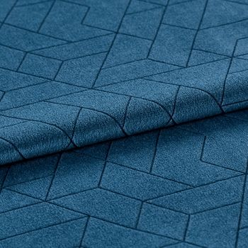 Folded dark blue material with a repeating geometric pattern
