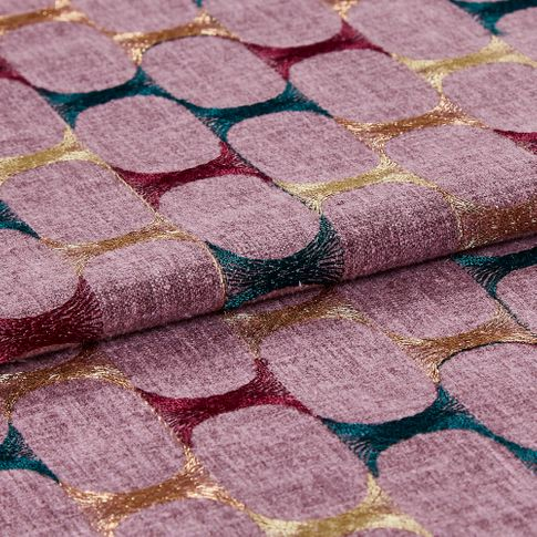 Folded material that has an intricate repeating purple pattern that has fine copper, blue and purple detail across the fabric