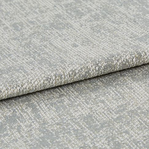 Grey shimmering material with dark grey layered into the fabric to create a layered look