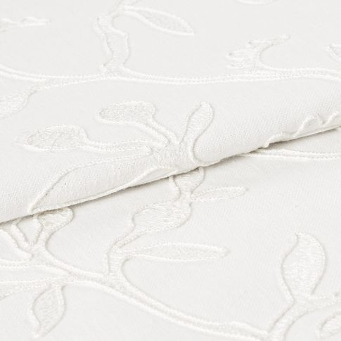 White coloured fabric of Adhara Whisper with detailed stem design woven into the material
