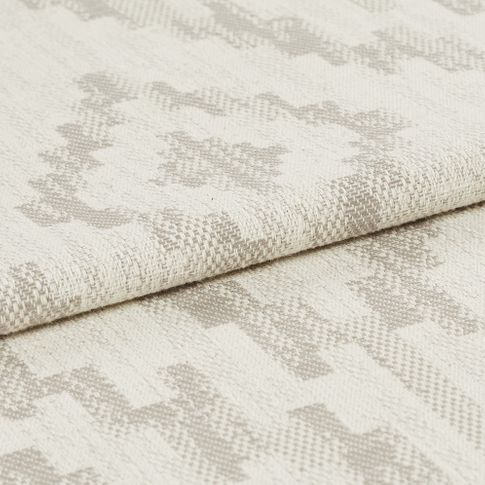 Cream coloured fabric with grey highlights that are scattered in a repeating pattern across the whole fabric