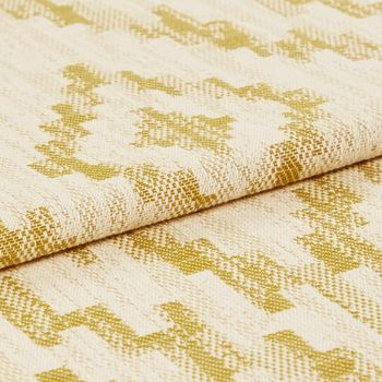 Cream coloured base fabric that is folded and designed with a yellow coloured tribal design that repeats across the material