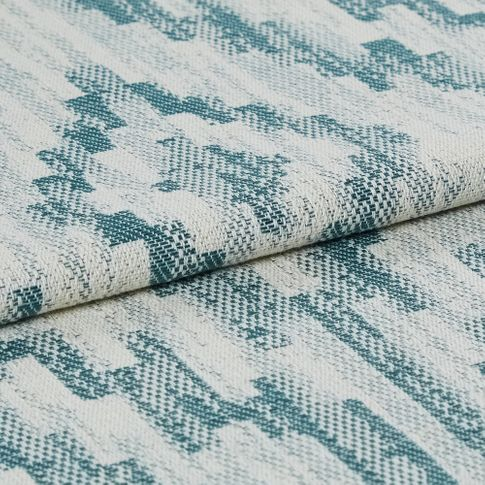 White coloured fabric decorated with patterned stripes of teal across the entire fabric