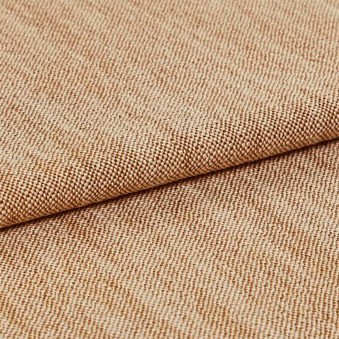 Fabric decorated in a bright sand colour while the material has been folded over
