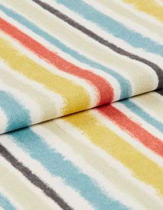 Fabric that is decorated with multicoloured vertical stripes in a repeating pattern