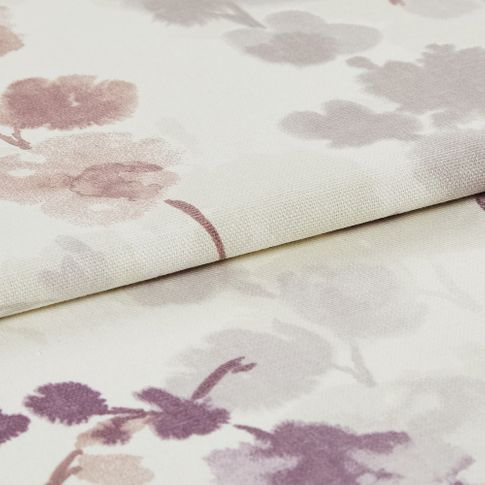 folded fabric with a repeating floral pattern in purple, pink and grey