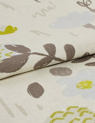 cream coloured fabric with repeating floral patterns in a a variety of colours including brown, grey, green and beige