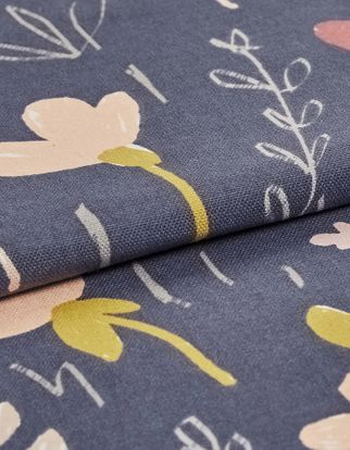 Dark blue fabric decorated with a repeating pattern of flowers in various styles