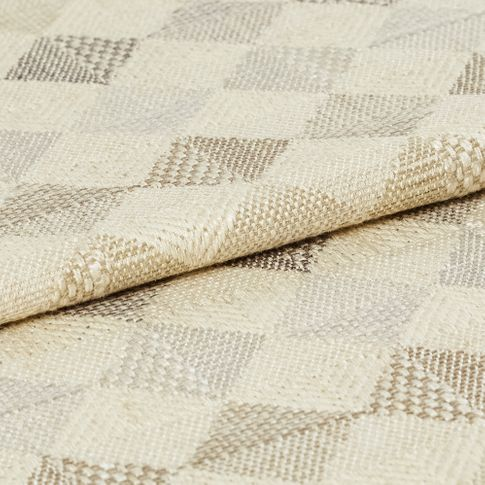Repeating geometric diamond patterns are decorated in neutral tones of grey and beige against cream coloured fabric
