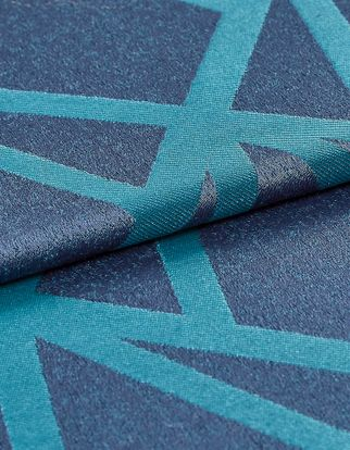 The base material is navy blue but the fabric also has a geometric design in a lighter shade of aqua blue