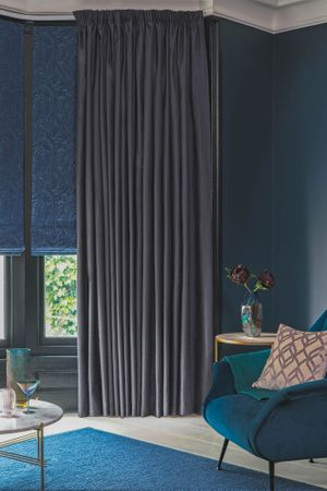 Midnight curtains in living room bay window