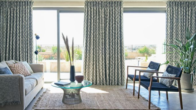 Alto Deep Indigo curtains on sliding doors in a living room