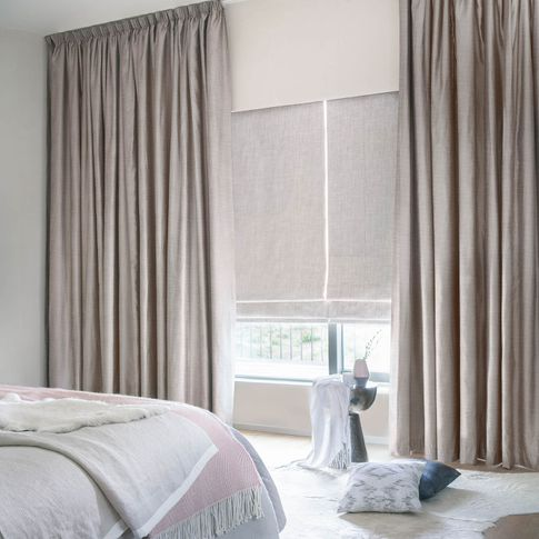 Arlington shingle curtains and allure bamboo Roman blinds in a bedroom