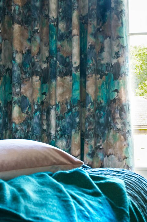 Close up of Aurora Lagoon curtains in bedroom