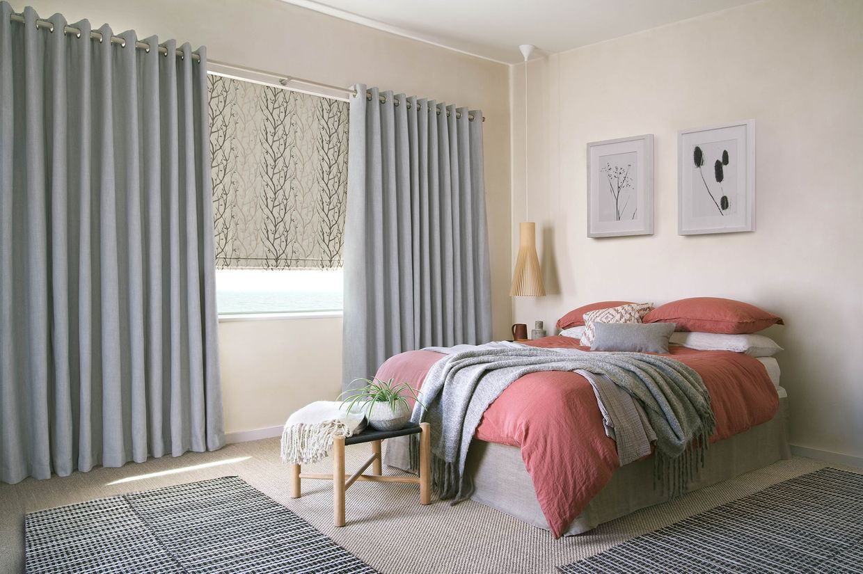 Bailey cloudy  curtains and pyrus cream romans in bedroom